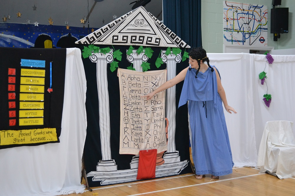 Students are learning about the ancient Greek alphabet