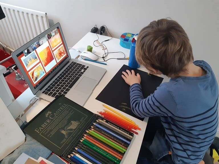 A child participating in an art class over Zoom