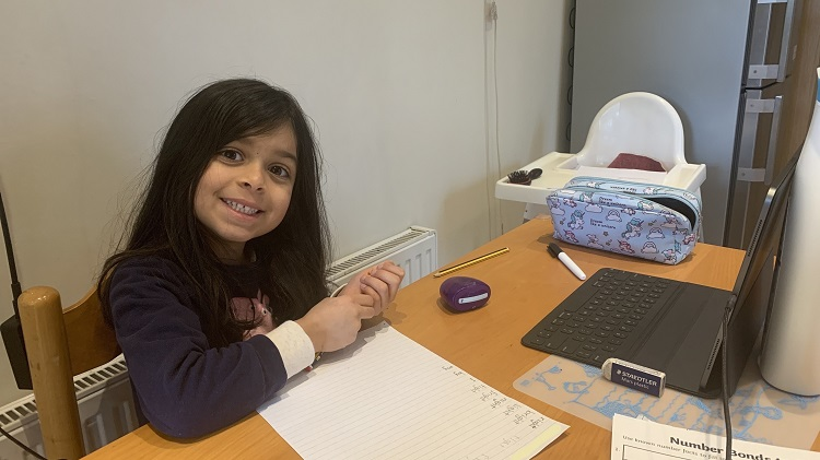 A year 1 student working on their spelling work at home