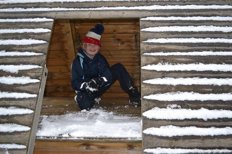 A child making a snowball