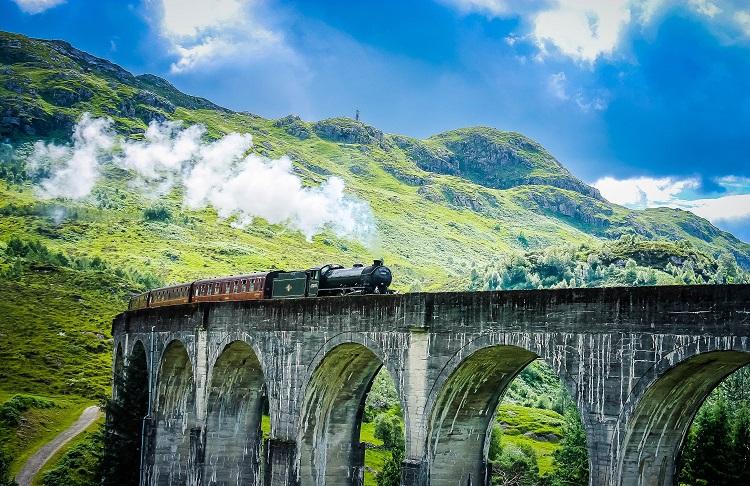 steam train crossing bridge