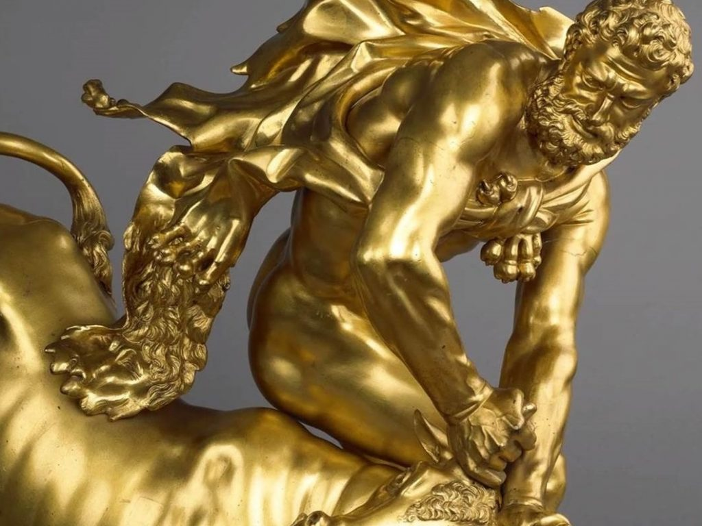 golden statue of a bearded man