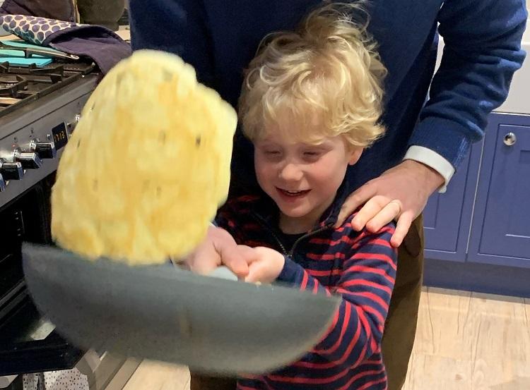 child making pancakes