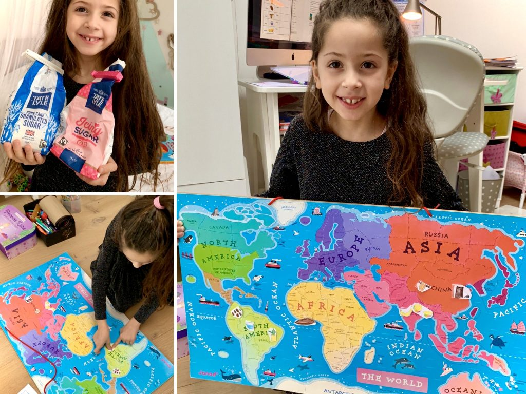 girl holding map of the world poster