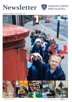 group of young children queuing at a postbox